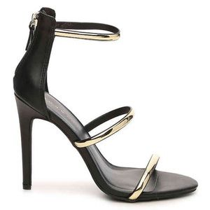 Bebe Women's Berdine Dress Sandal Black/Gold 8M